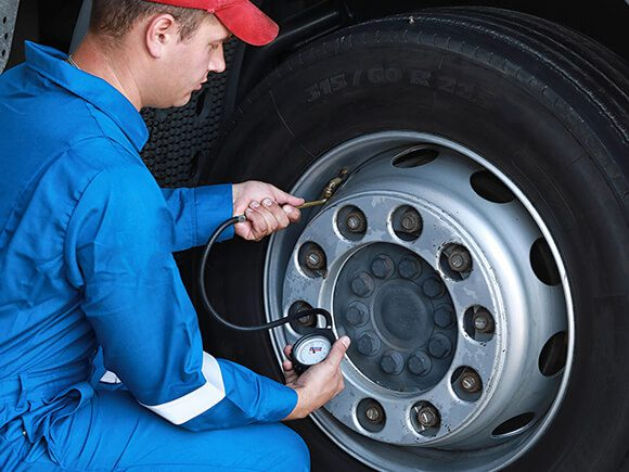 EMT Checking the tire air of the truck
