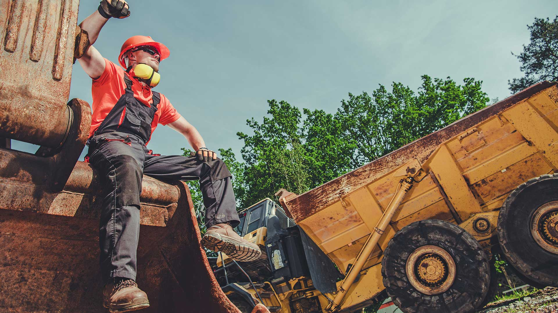 Heavy Equipment Owner Operator sitting on heavy equipment