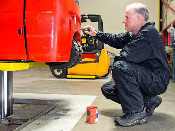 EMT Forklift repainting in garage