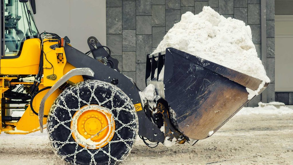 Heavy equipment fitted with snow chains